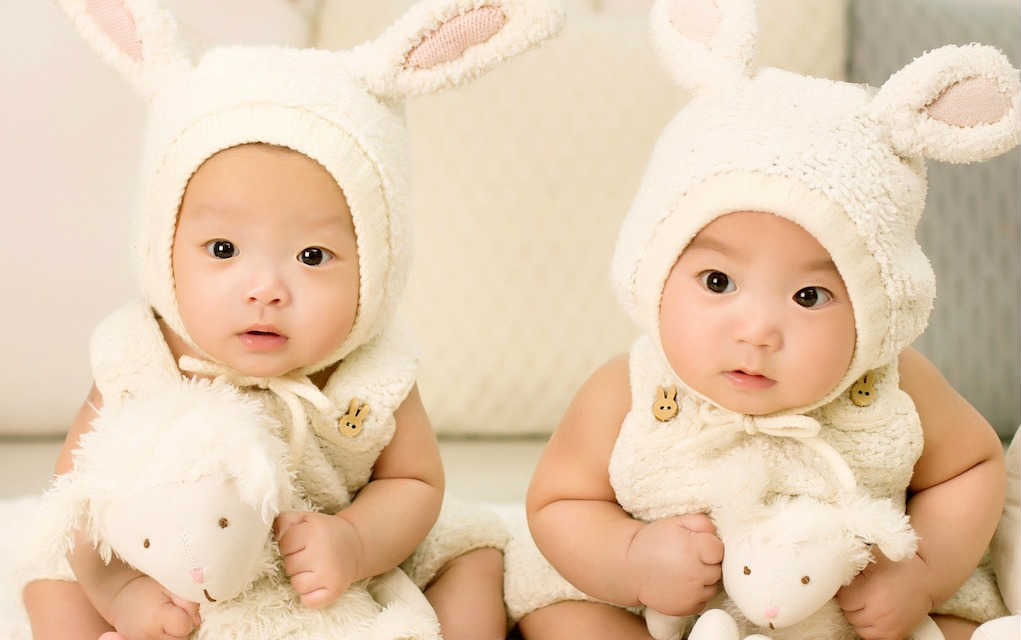 two babies in bunny costumes for unisex baby names